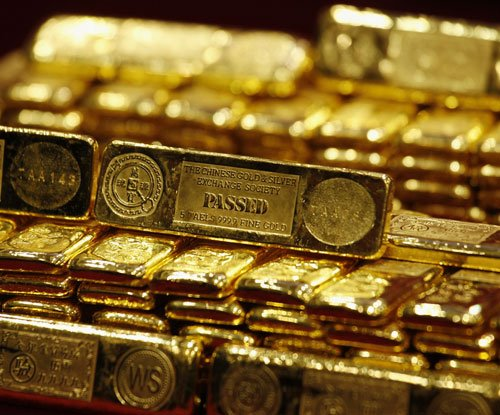 Gold slides for fourth day on lower demand, global cues