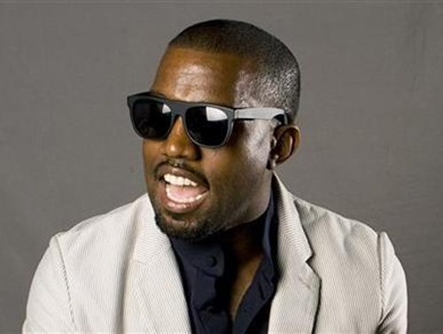 Kanye West charged over incident with photographer