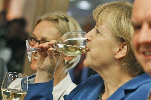 Merkel wins third term but falls short of absolute majority
