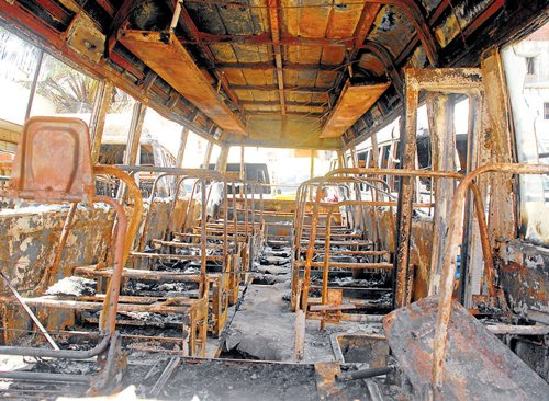 Fire 'mishap' kills driver, 4 buses gutted
