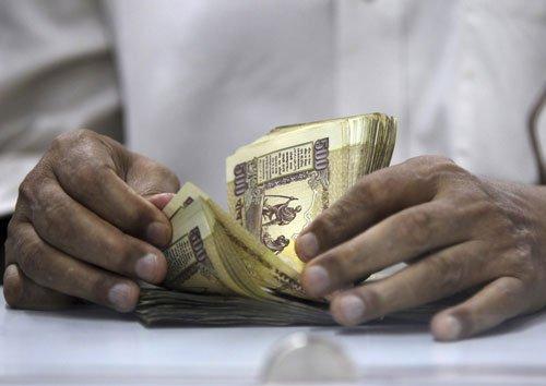 Rupee trims initial gains vs dollar, still up 17 paise