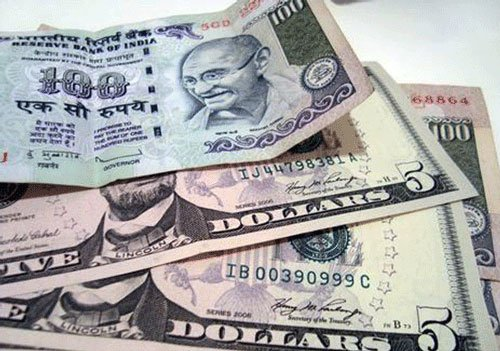 Rupee trims early gains vs dollar, still up 23 paise