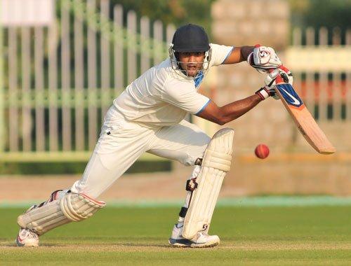 Karnataka takes lead on back of superb batting show