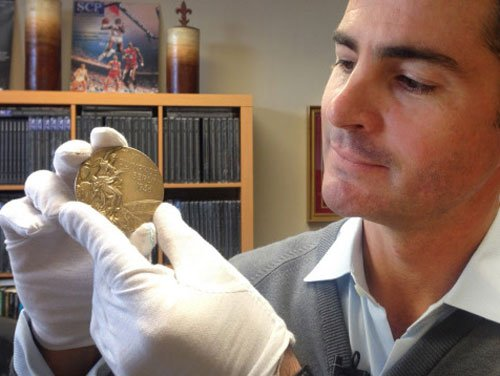 Owens' 1936 Olympic gold fetches USD 1.4 million
