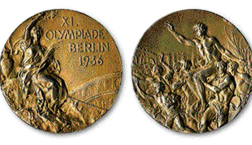 Owens' gold medal breaks the auction barrier