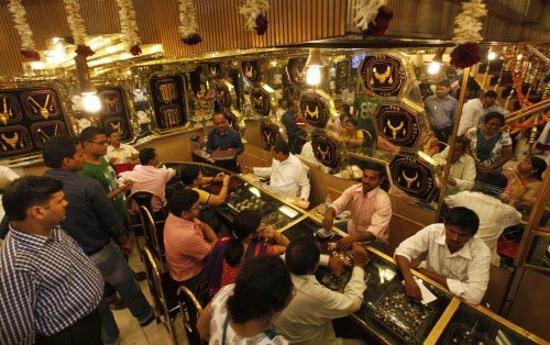 Gold, silver spurt on frantic buying, strong global cues