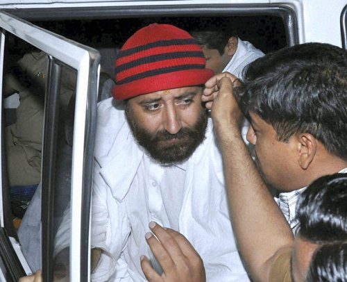 Narayan Sai aides detained for bribing cops; Rs 5 crore seized