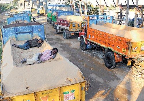 Sand transporters' stir hits construction