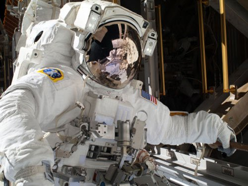 NASA astronauts step out on Christmas Eve spacewalk