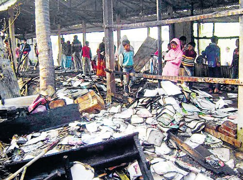 Bangladesh burns on poll eve