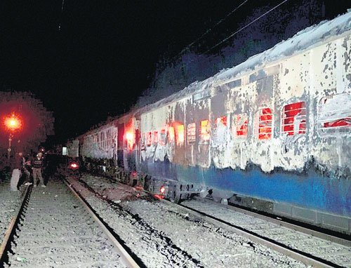 Another train fire, nine killed