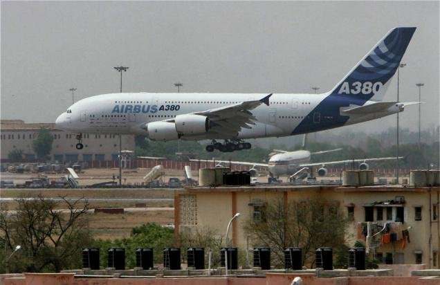 Airbus posts record orders, ponders raising  production
