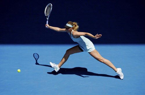 Sharapova survives scare to stay alive