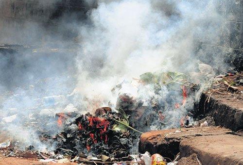 Festival over, contractors make bonfire of garbage
