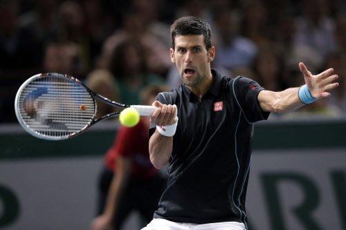 Djokovic, Serena move on easily