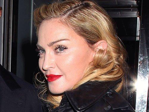 Madonna apologises for racist slur