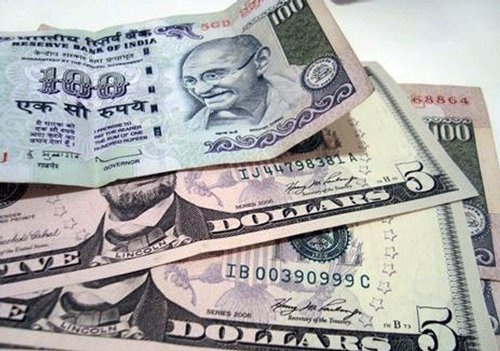 Re falls 26 paise to one-week low of 61.88 against dollar