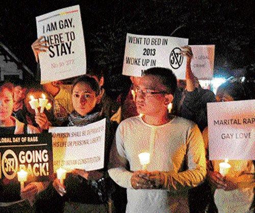 LGBT community holds candlelight vigil