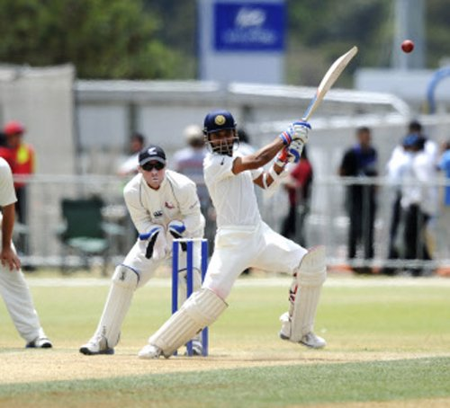 Rohit shines on dull day
