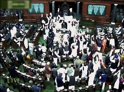 Fisticuffs, pepper spraying marks tabling of T-bill in Lok Sabha