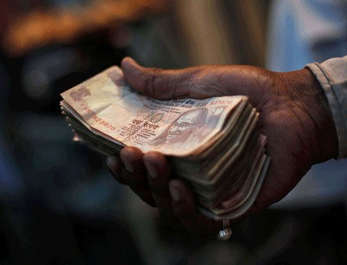 Re rebounds 49 paise vs $  to end at 61.93