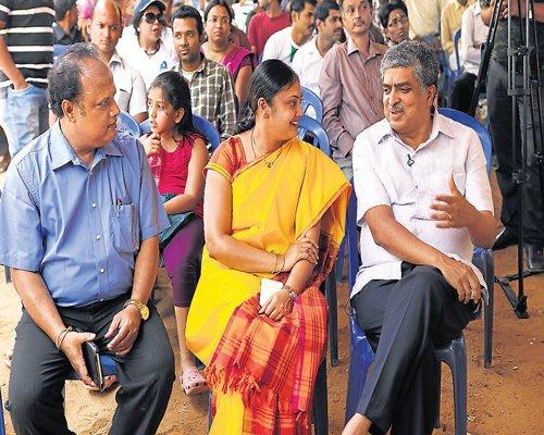 Billionaire Nilekani sweats it out at hustings in Bangalore South
