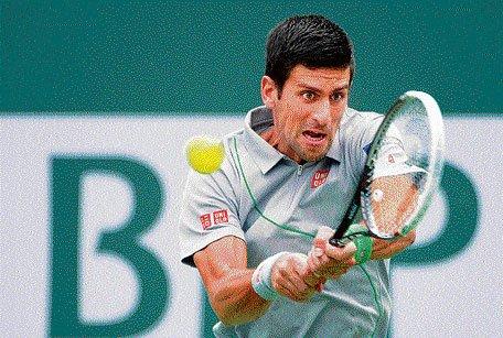 Djokovic sails safely into fourth round; Li wins
