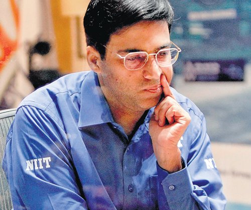 Anand draws but stays in front with sole lead