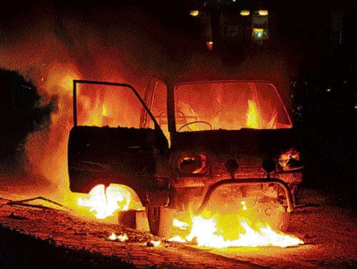 Family rescued as car catches fire