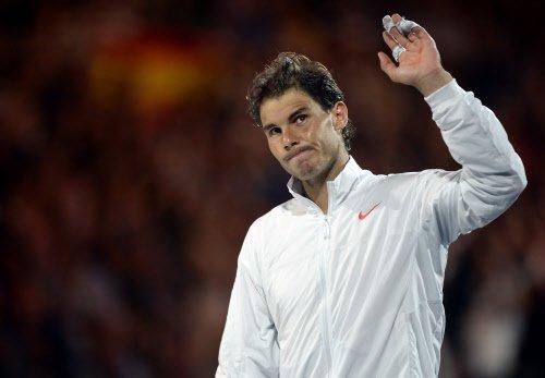Fiery Nadal brushes Hewitt aside