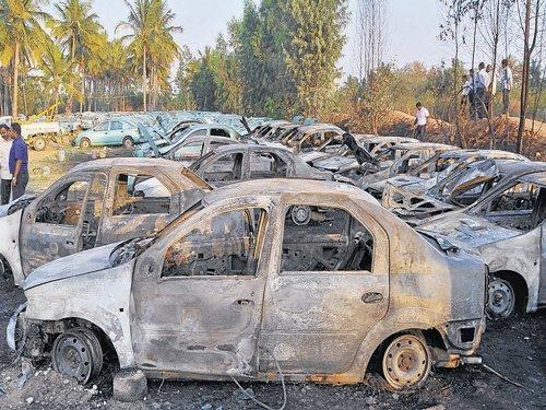 Fire destroys 24 old cars at dump yard