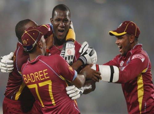 Gayle, Sammy win it for West Indies