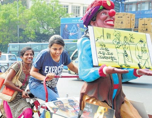 Children tag along with NOTA campaigners
