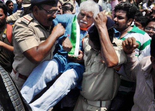 Mistry arrested for removing Modi poster
