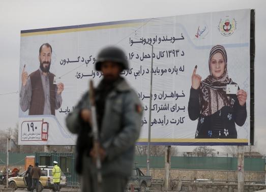 Landmark Afghan election begins under shadow of violence
