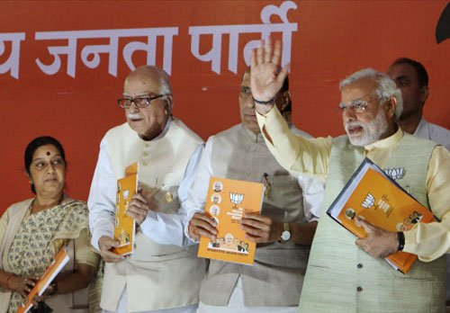 BJP vows to end policy paralysis, check prices