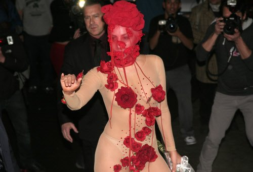 Gaga uses tape to shape her face
