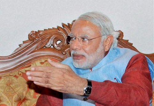 Modi alleges distribution of watches with Chidambaram's pics