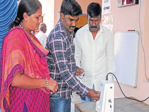 Token system, waiting area, LCD screens please voters at model polling stations