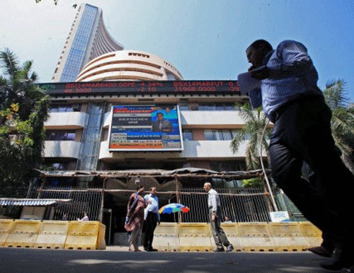 Sensex slips from record high on profit-booking