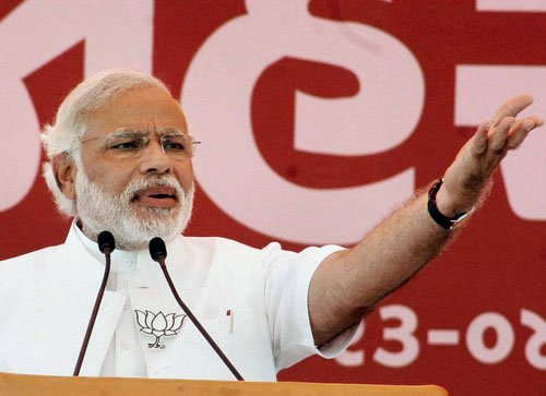 Punish the `mother-son' government, says Modi