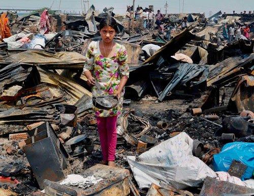 Eight injured, around 1000 jhuggis gutted in fire