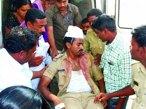 Mob attacks police party; five injured