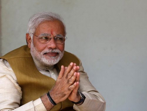 Modi storms to power; gets absolute majority for BJP