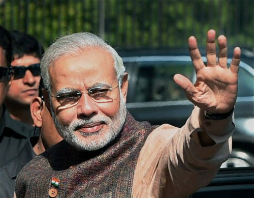 Don't touch my feet, focus on work: Modi to MPs