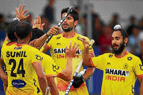First win for India, Australia storm into semis