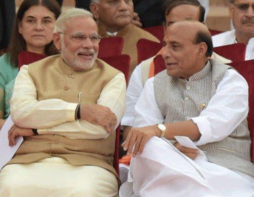 Rajnath follows Modi, allots duty to MoS