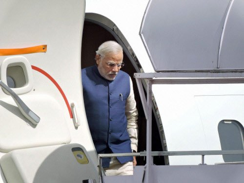 Modi arrives in Bhutan on his first foreign visit as PM