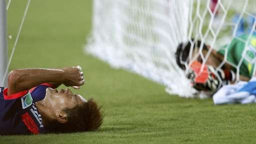 Ten-man Greece hold Japan to goalless draw