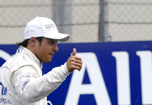 Massa takes surprise pole